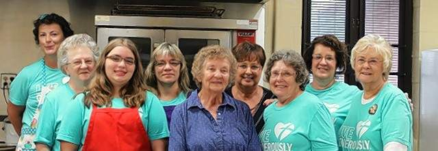 St. John volunteers worked the Olive Oyl Cafe during the 39th Annual Popeye Picnic. Front row from left, Hannah Kaempfe, Carol Colvis, and Wanda Dethrone. Back row from left, Edna Neislein, Carol Kaempfe, Laura Vasquez, Amber Cushman and very back row Lisa Meade.