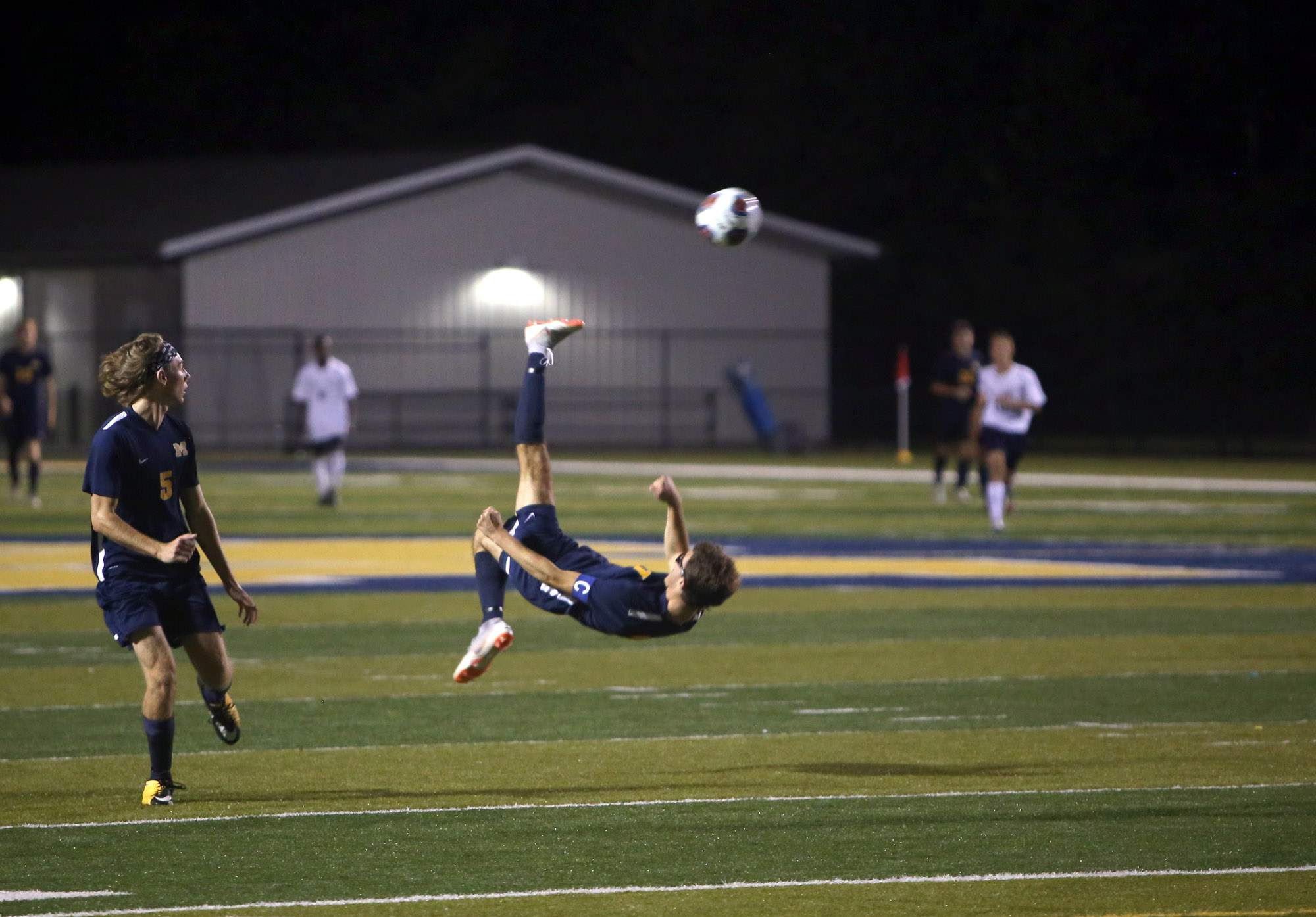 Tyson Stoecklin attempts a bicycle kick Monday night.