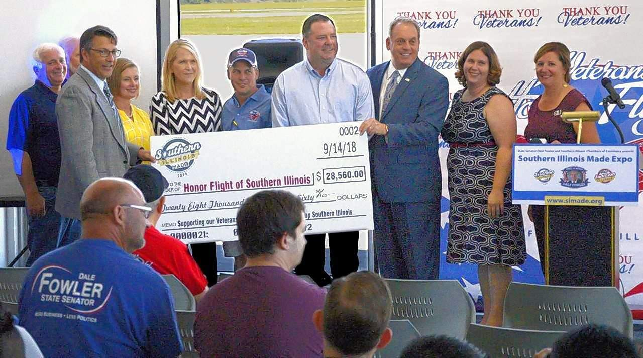 State Sen. Dale Fowler presents a check for $28,560 to Veterans Airport of Southern Illinois manager Doug Kimmel and other representatives of Southern Illinois Honor Flight Friday at the airport.