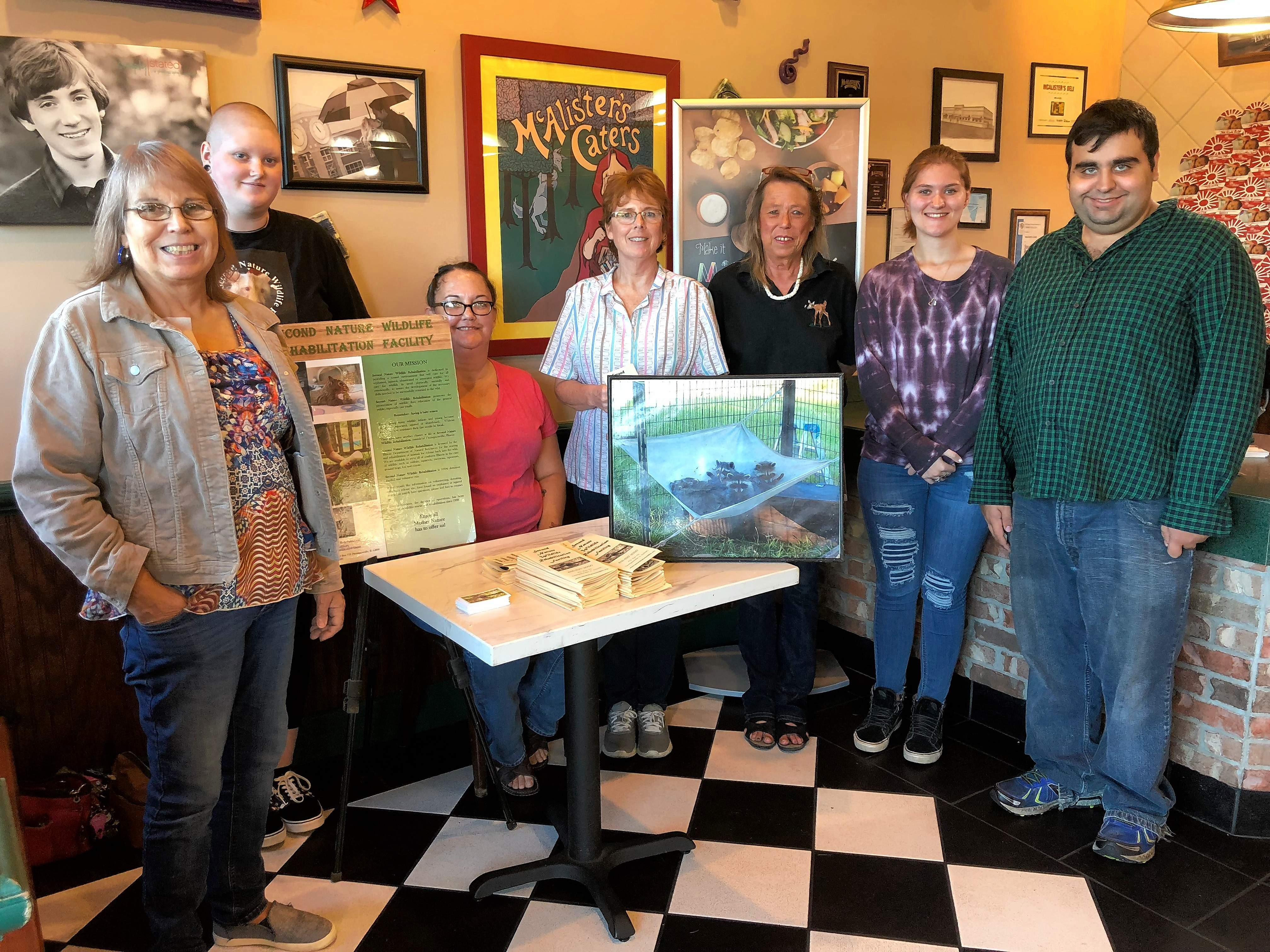 A group of volunteers from across southern Illinois came together to help raise funds for Second Nature Wildlife Rehabilitation on Monday evening. From left are Gail Venegas, Violet Pearce, Chelsea Meisner, Amy Langle, Pam Sundeen, McKenzie Newsome, and Neil Venegas worked a shift at the Marion McCallister's to earn donations.