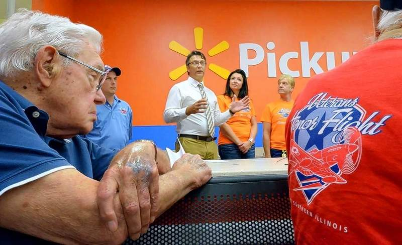 Veterans Honor Flight of Southern Illinois chairman Bryan Questelle, in shirt and tie, addressed those gathered at the Marion Walmart store Wednesday to discuss plans for the next flight scheduled set for October.