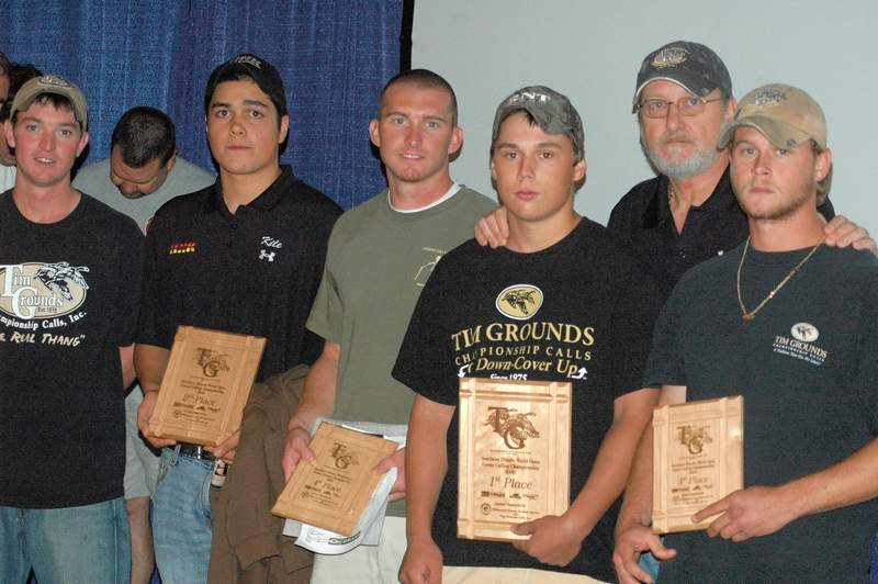 Here, Tim Grounds is pictured with participants (including son Hunter, far right) in one of the many Goose Calling Competitions he sponsored over the years at John A. Logan College