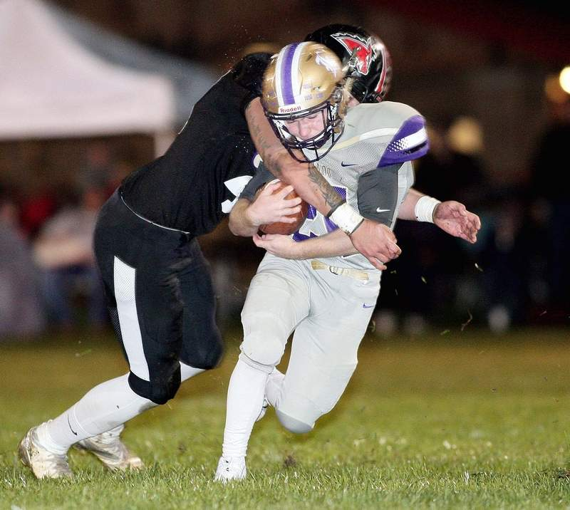 Eldorado halfback Clayton Dennis is met by a Fairfield defender as Dennis works his way downfield in the first half Friday night on the road in a Black Diamond Conference showdown.