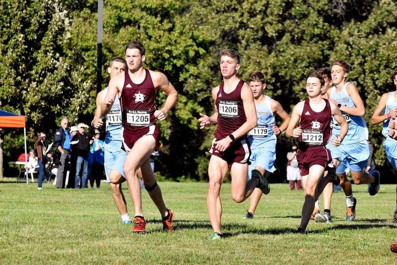Benton runners, from left, Mason Wills, Avery Potter and Chance Owens, came out of the gate quickly at the start of the conference cross country meet at John A. Logan College on Thursday. Benton finished 2-through-5 as individuals to capture the team title.