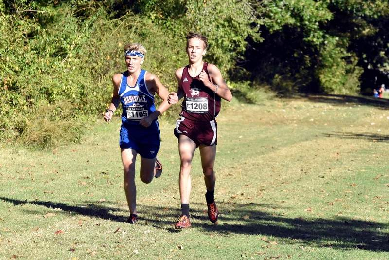 Benton High School's Joey Sample runs side-by-side with a Nashville runner during the River to River Conference cross country meet at Carterville on Thursday. Sample finished second in the Ohio Division with a time of 16:28.4.