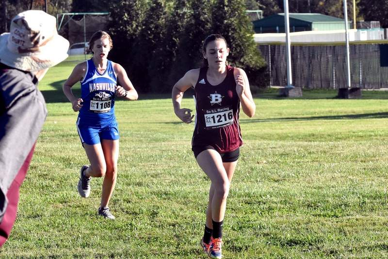 Benton High School sophomore Addyson Miller runs toward the finish line on the three-mile course at John A. Logan College on Thursday during the conference meet. Miller placed third as an individual as the Rangerettes won the team title.