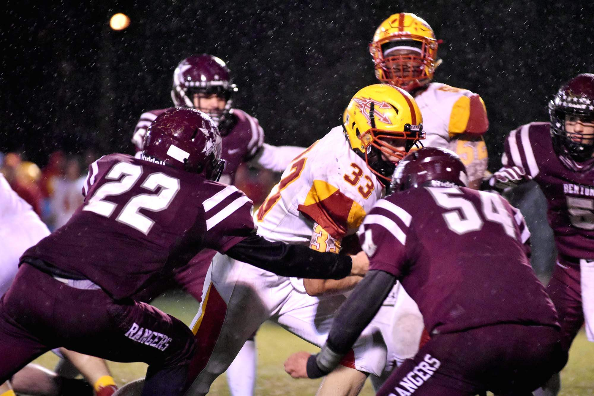 Murphysboro's Aiden McNitt runs up the middle and is met by Benton defenders Jadon Stark (22) and Logan Williams (54). McNitt ran for 68 yards, including an 18-yard touchdown.