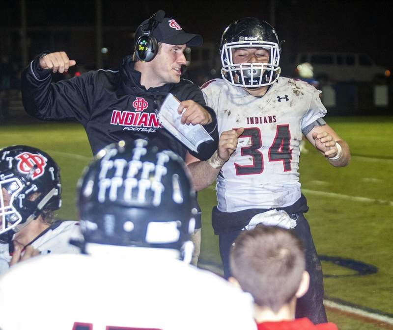 Du Quoin coach A.J. Hill celebrates with Westly Milam after his first touchdown.