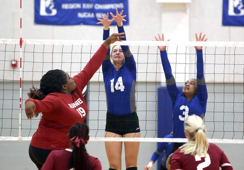 Bryleigh Buchanan puts down a block against Robyn Foote in Logan's match against Shawnee College on Thursday.