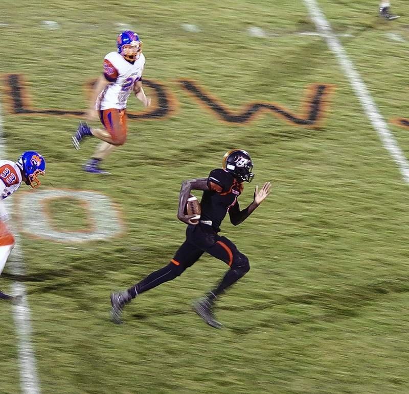 Chester High School wide receiver Keith Kiner III runs for a touchdown on a 64-yard pass from quarterback Nick Meyer on the first play of the second half Oct. 12. CZR Bearcats Noah Hervey (28) and Greg Fletcher (33) chase Kiner.