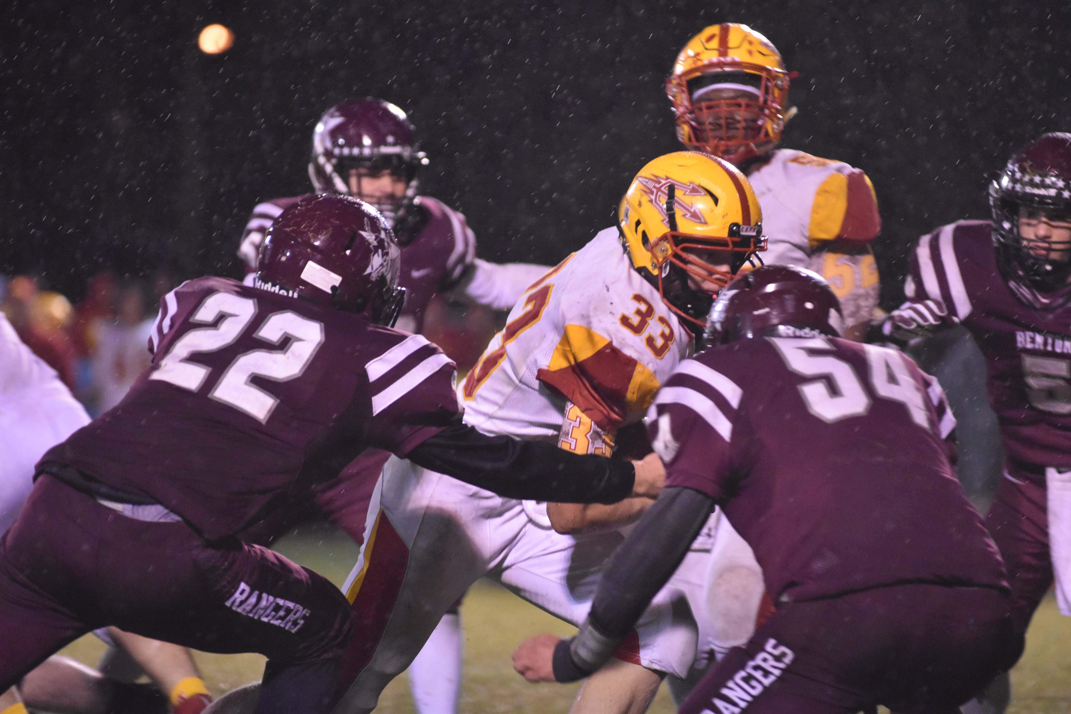 RICK HAYES PHOTOMurphysboro's Aiden McNitt runs up the middle and is met by Benton defenders Jadon Stark (22) and Logan Williams (54). McNitt ran for 68 yards, including an 18-yard touchdown.