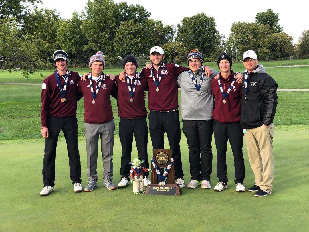 Benton's golf team poses with their state runners-up trophy after competing in cold, rainy conditions at Weibring Golf Club in Normal this past weekend. From left: Brendan Luster, Eldon Owens, Brad Hammond, Robbie Moore, Collin Miller, Jared Shaw and Coach Reggie Norman.