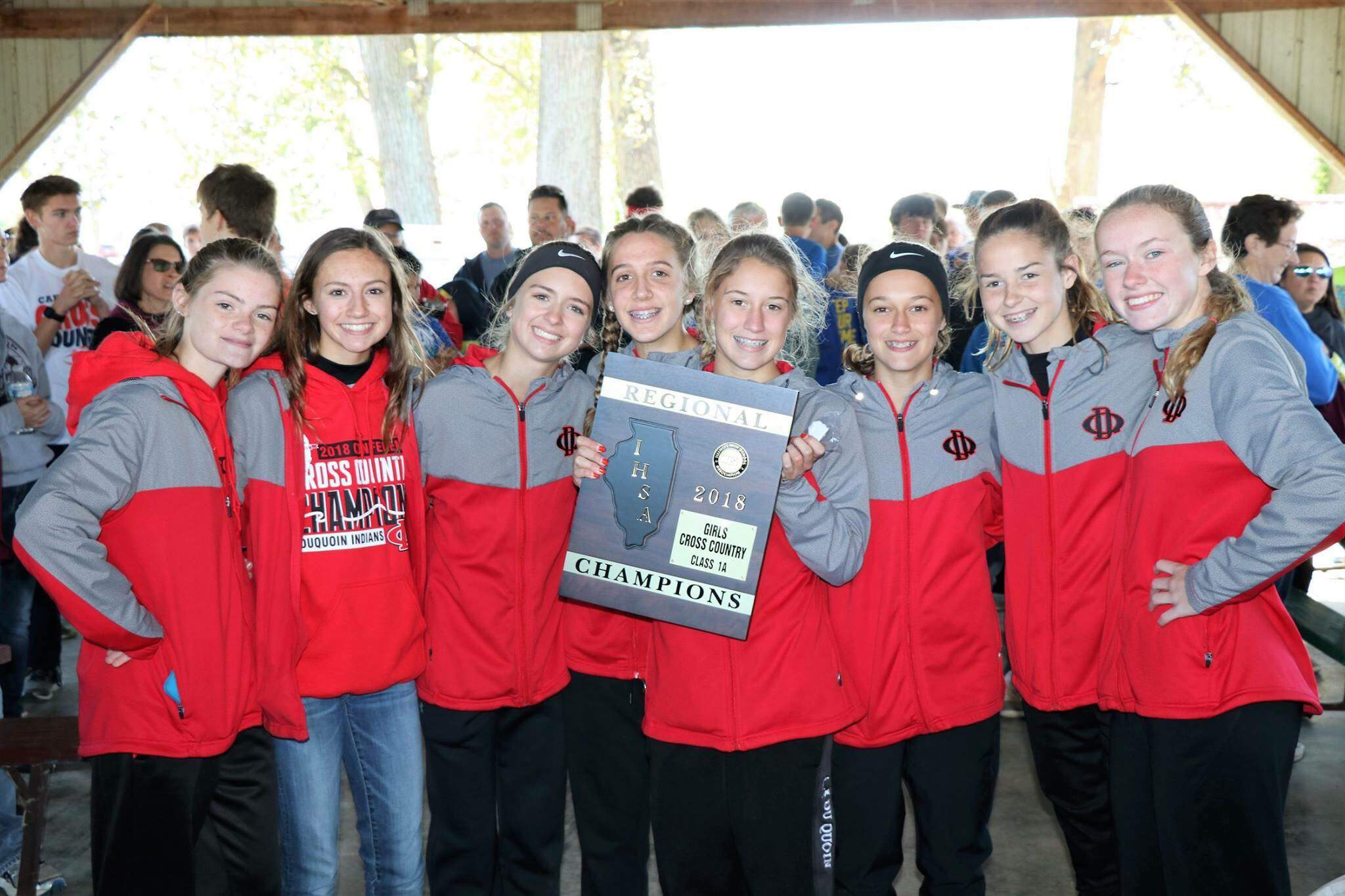 Du Quoin's girls cross country team poses with the Du Quoin 1A Regional championship plaque.
