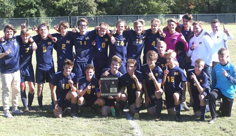 The Marion High School boys soccer team poses with the Effingham 2A Regional championship plaque Saturday in Carbondale.