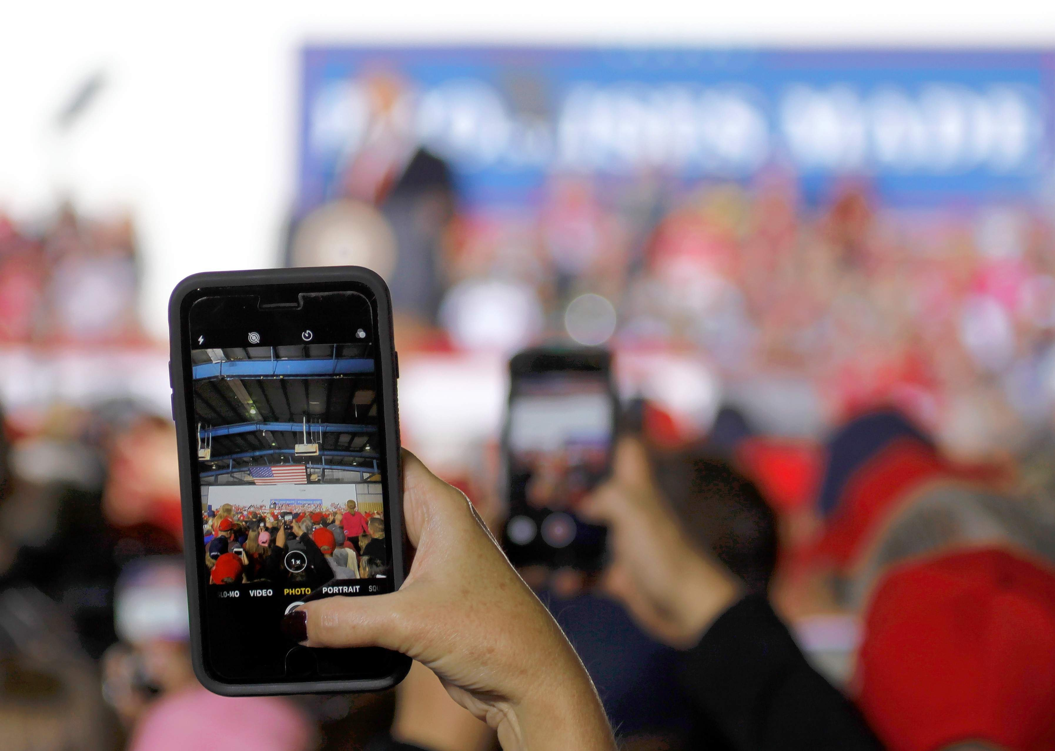 A cell phone user captures the scene during President Trump's rally Saturday at the Southern Illinois Airport.