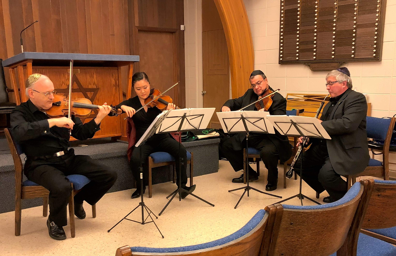 Michael Barta, Sophia Han, Juan Carlos Siviero and Edward Benyas provide music for the memorial service at Beth Jacob Temple in Carbondale.