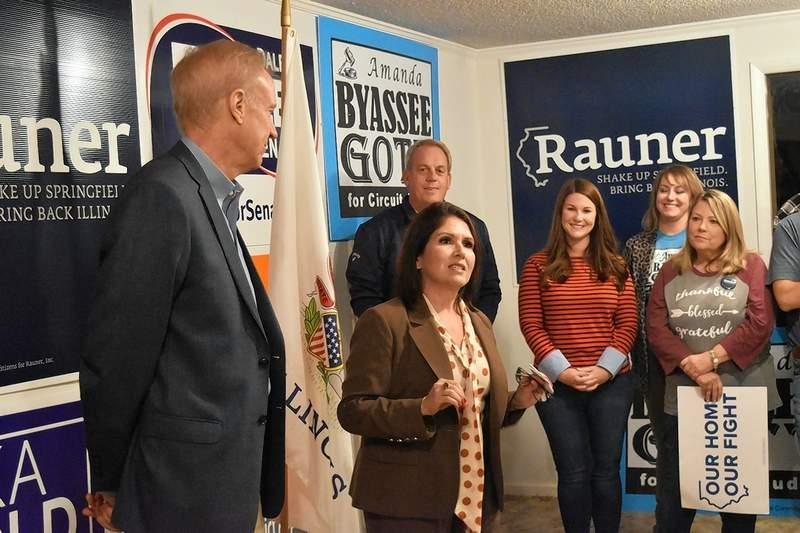 Lt. Gov. Evelyn Sanguinetti, with Gov. Bruce Rauner, left, speaks at a Harrisburg rally on Friday night.