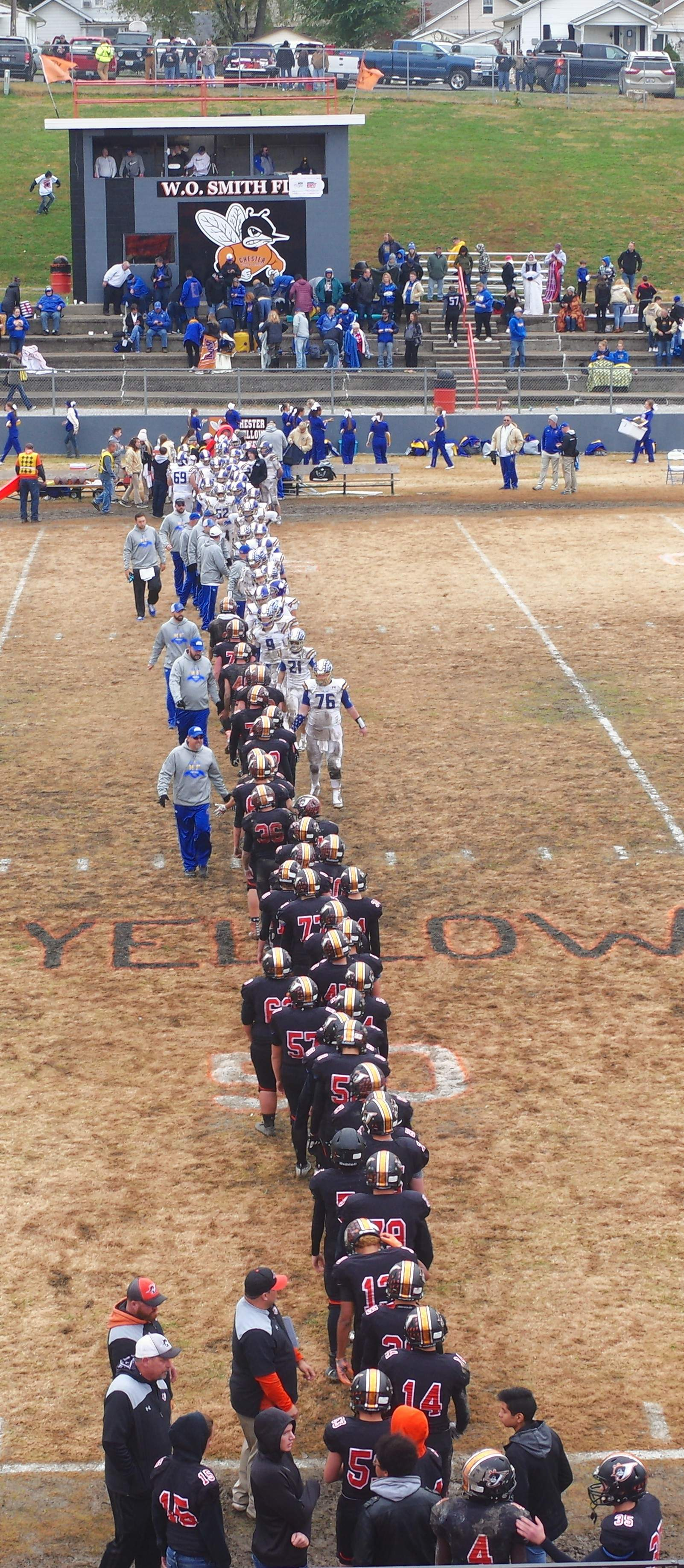 The Chester YellowJackets and the Maroa-Forsyth Trojans shake hands and congratulate each other following the completion of the Sweet-16 game of the 2018 IHSA Class 2A Football Playoffs.