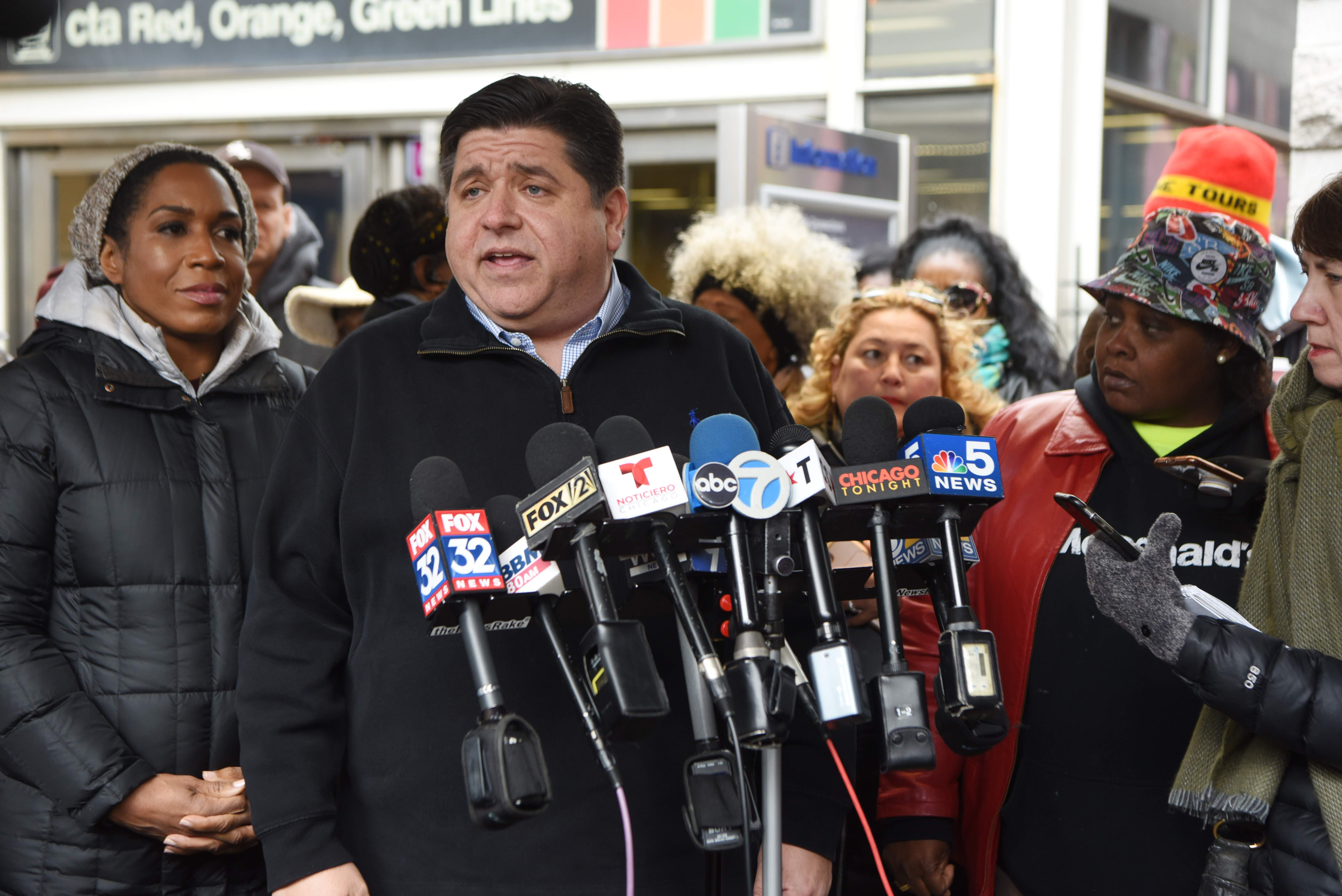 Gov.-elect J.B. Pritzker and lt. gov.-elect Juliana Stratton, left, speak to the media and greet supporters in Chicago.