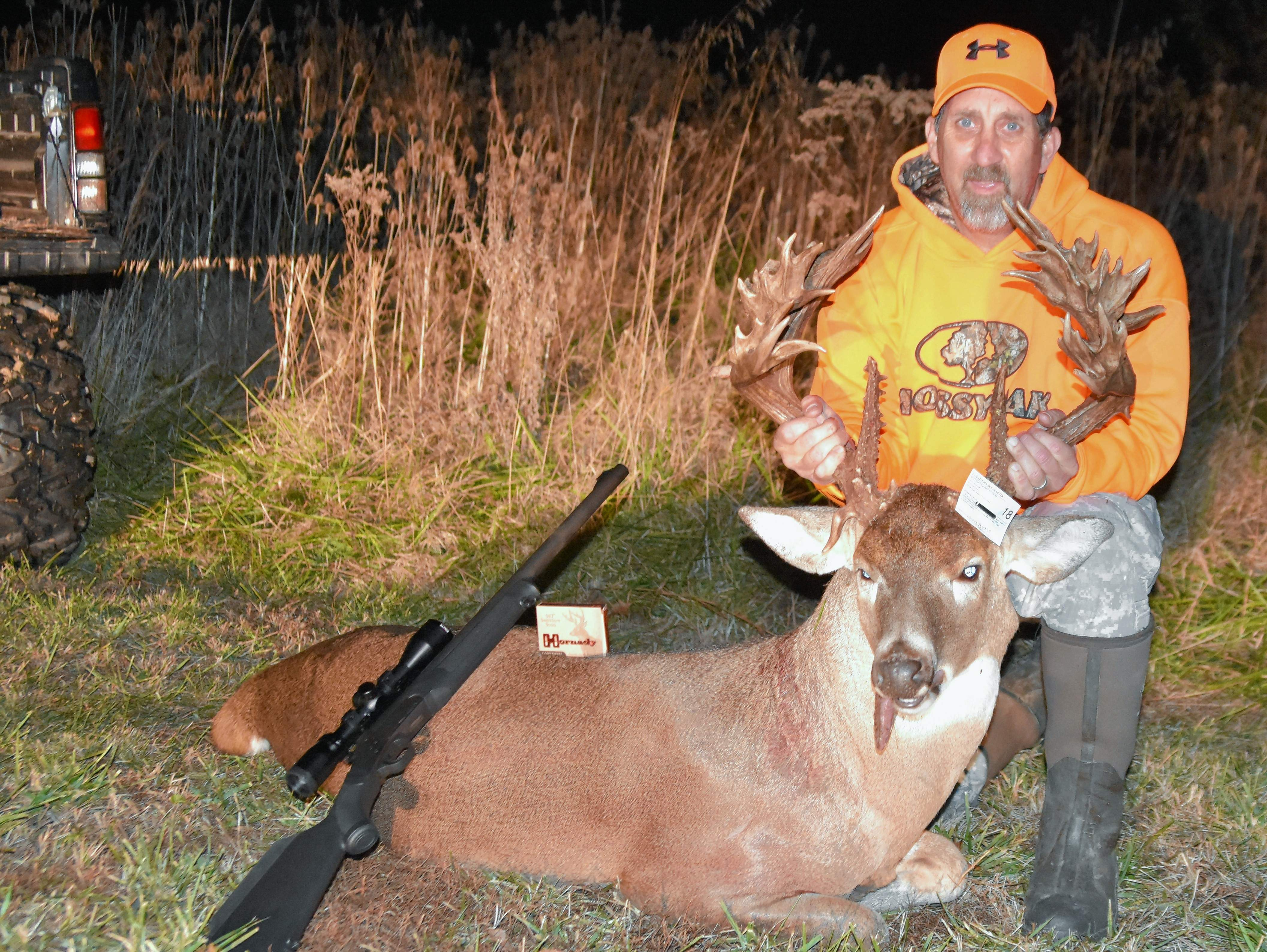 Keith Szablewski poses with his 'buck of a lifetime' he shot in rural Marion on Saturday. The deer is estimated to be at least a 33-pointer weighing around 275 pounds.