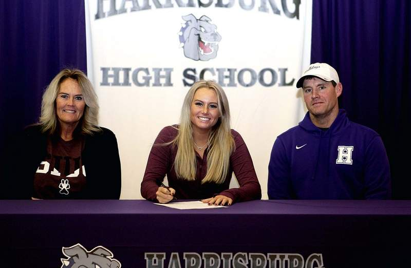 Devin Butler, with her parents, Angi and Jason Butler signed scholarship papers to continue her soccer career at Southern Illinois University. The Harrisburg senior will be a part of SIU's first team.