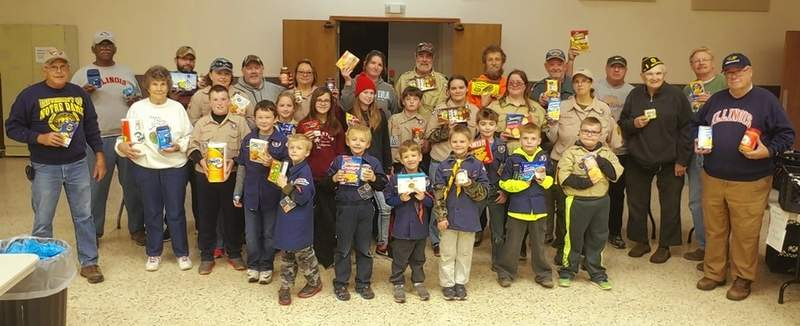 Chester Boy Scouts and Chester Area Christian Food pantry personnel stop sorting and boxing the donated food long enough for a group photo inside Grace Church Ministries.