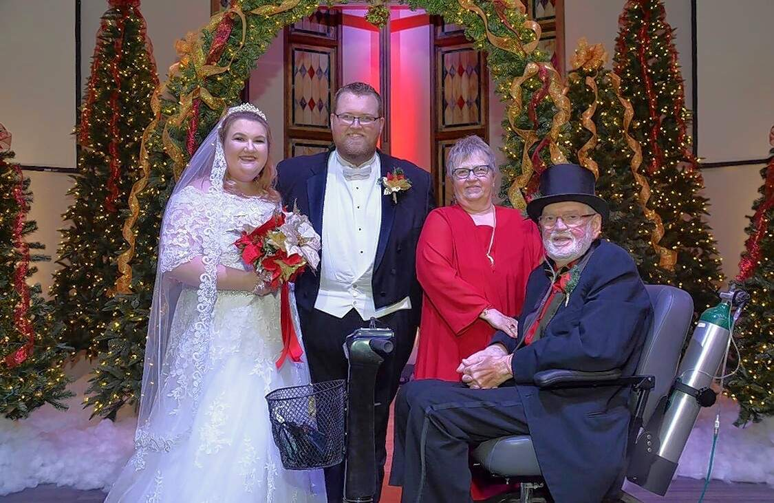 Johnston City Mayor Jim Mitchell, right, with his wife Jeannie, and son Grant and bride Abbie, at the pair's wedding on Dec. 1.
