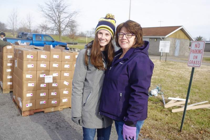 Taylor Dunning, left, and her mother Rhonda, help out with the December Mobile Market.Taylor is a student at Webster University in St. Louis where she runs track and cross country and is in pursuit of a medical degree. On a regular basis the CACFP has 20 or more volunteers to help with the monthly mobile market food distributions.