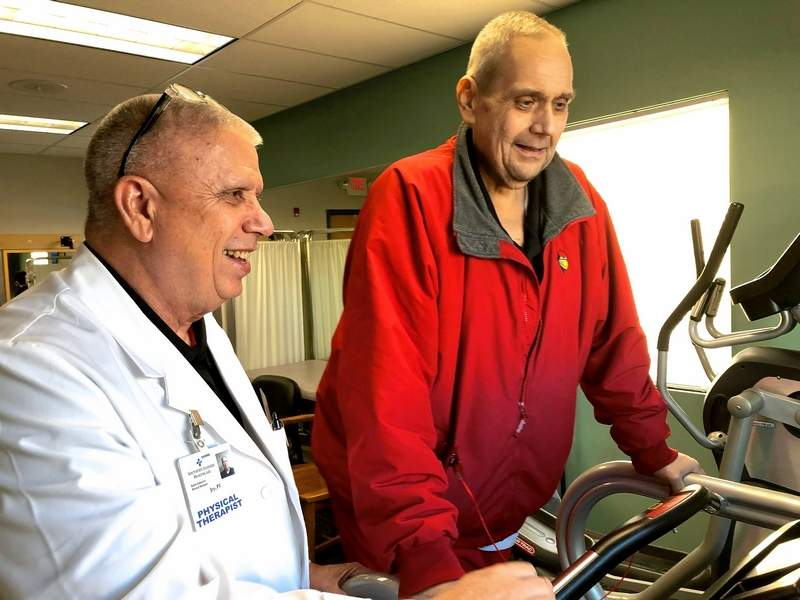 Jay Pardus, left, works with Bill Glodich at SIH's Rehab Unlimited in West Frankfort.