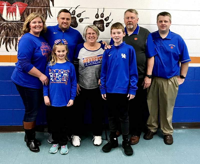 The Hobbs family gathers for a photograph at Christopher Jr. High School. In front, Tinley and Carson Hobbs. Back row: Tiffanie, Jason, Stephanie, Russ and Kyle Hobbs.