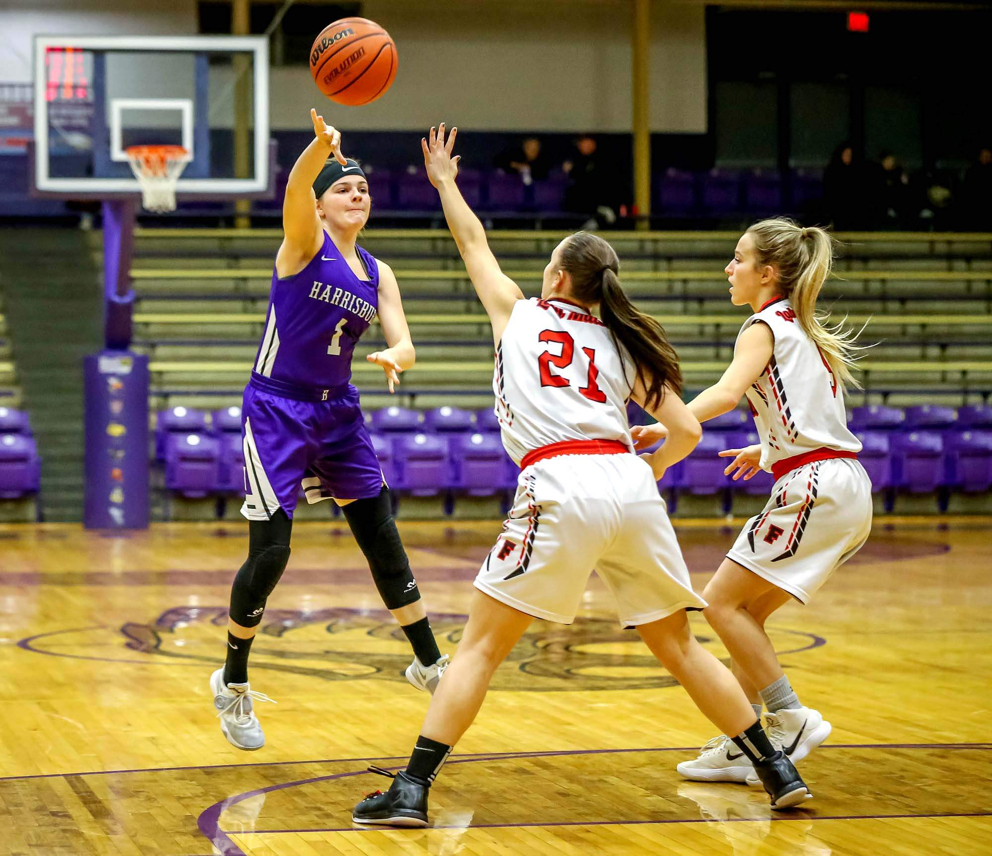 Harrisburg's Brooke Meylor looks for an open player against Fairfield Saturday at the Lady Eagle Mid-Winter Classic.