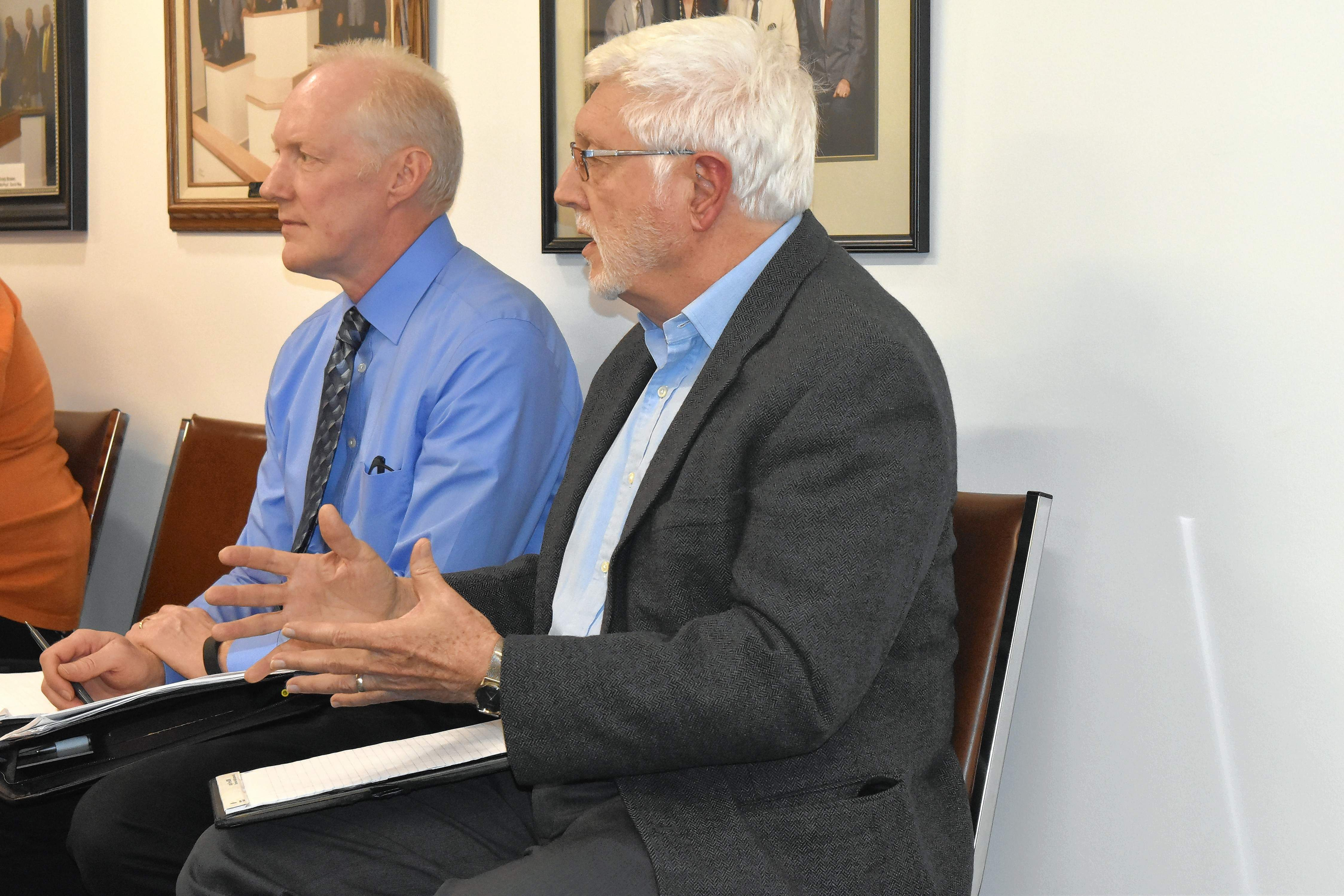 Gail White, right, principal owner of White and Borgognoni Architects, explains what his company will do for Franklin County officials in preparing a preliminary study and design for a new courthouse. At left is Van Voyles, principal architect.