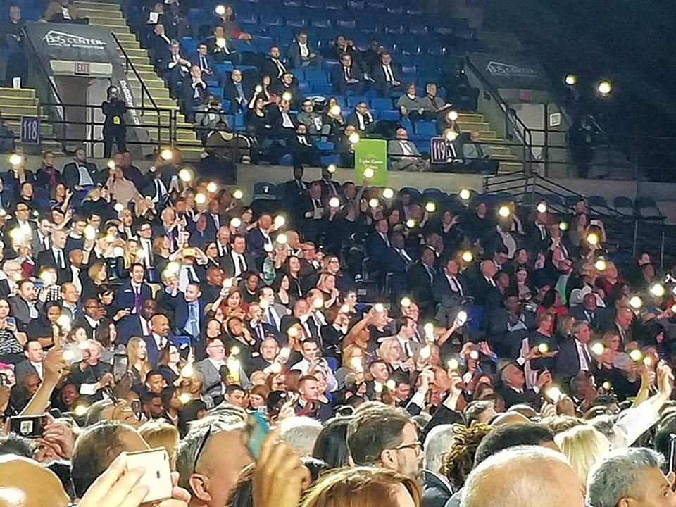 PHOTO COURTESY OF VIVIAN ROBINSONThose in attendance at Gov. J.B. Pritzker's inauguration use cell phones as lights prior to the swearing-in ceremony Monday.