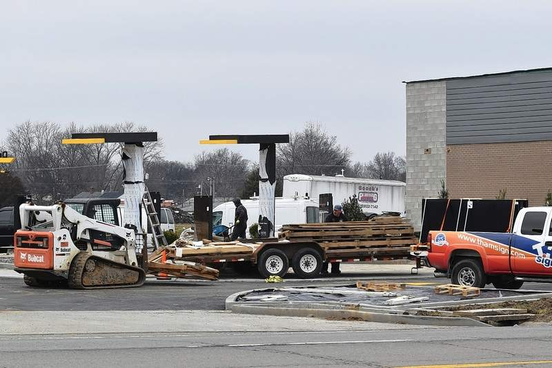 Construction workers clean up on the south side of the new Harrisburg McDonald's Wednesday afternoon.