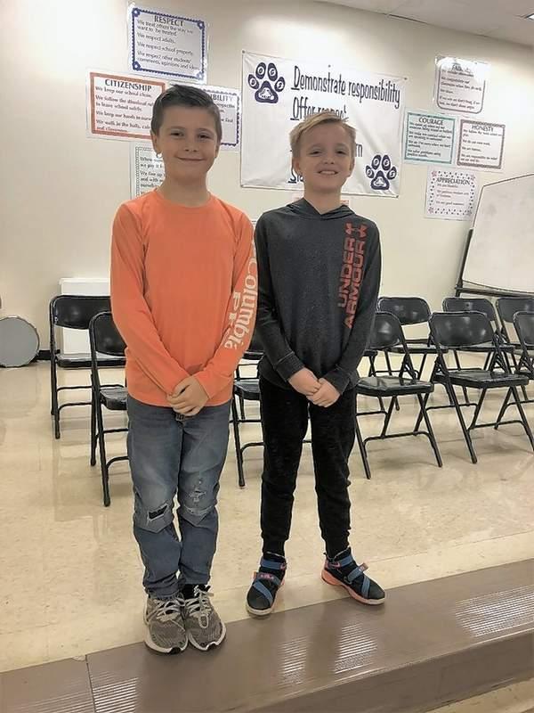 From left, fourth grade winner Ian Crabb and runner-up Dalton Wheeler.