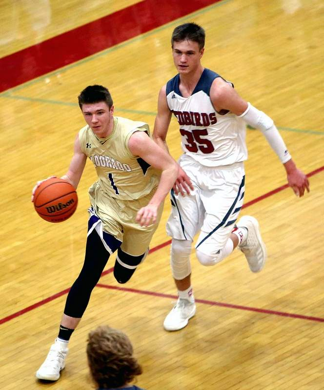 Eldorado freshman guard Townsend Barton dribbles away from the defense being applied by West Frankfort's CJ Johnson Friday night at the West Frankfort Mid-Winter Classic.