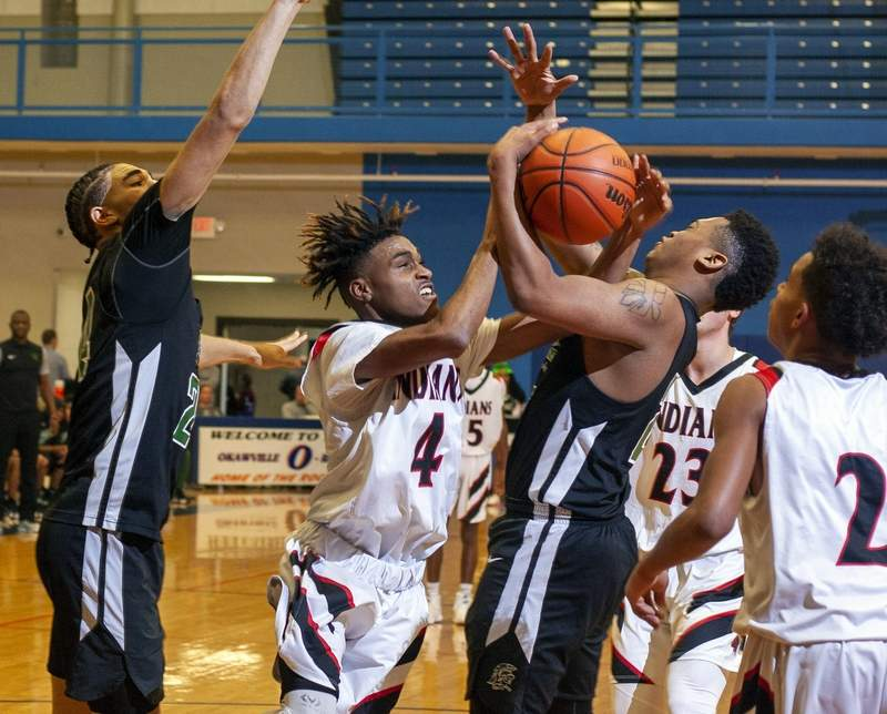 Anthony Cole battles for a rebound against Madison.