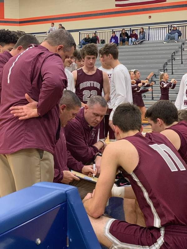 With the score tied and three seconds left on the clock, Benton coaches draw up a final play.