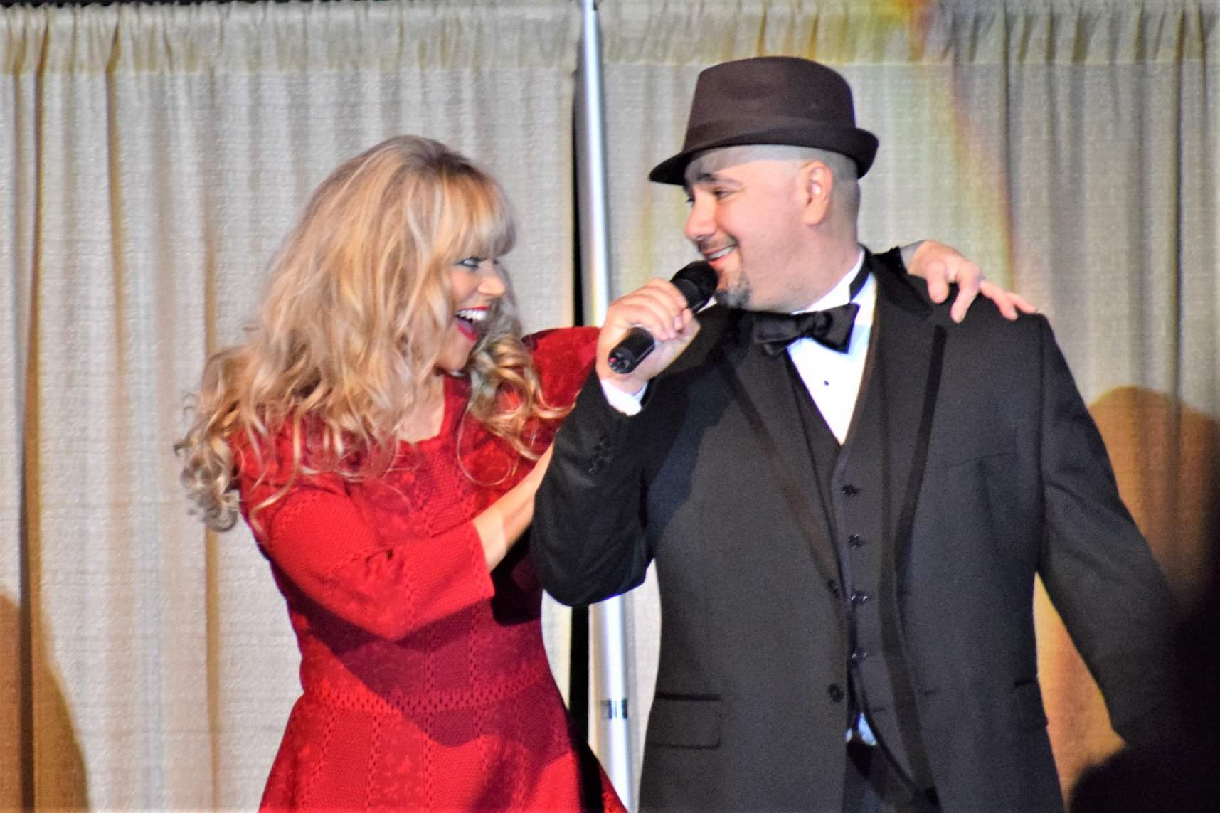 """Whitney Swift of Benton joins Carbondale's Alex Garrido, a geriatrician with SIH, for a performance of Frank Sinatra's """"You Make Me Feel So Young."""""""