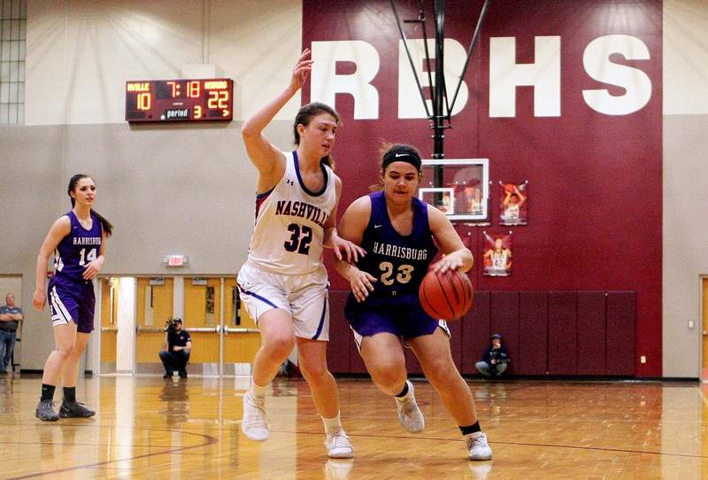 Harrisburg's Essence Sanders drives to the basket against Nashville's Alyssa Cole to start the second half Monday night at Red Bud High School in the Class 2A Sectional semifinal.