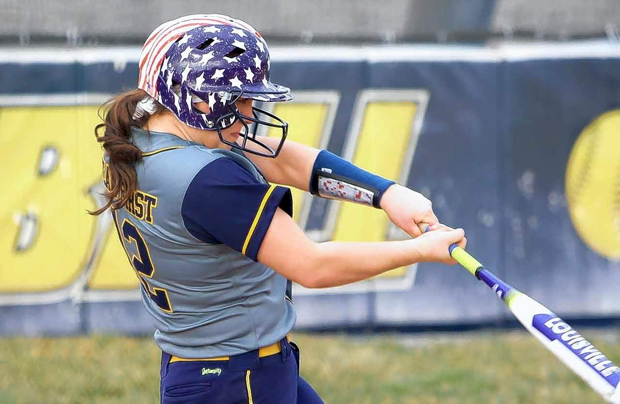Marion High's Tori Evans collects the second of her three hits in game action Wednesday at home against West Frankfort.