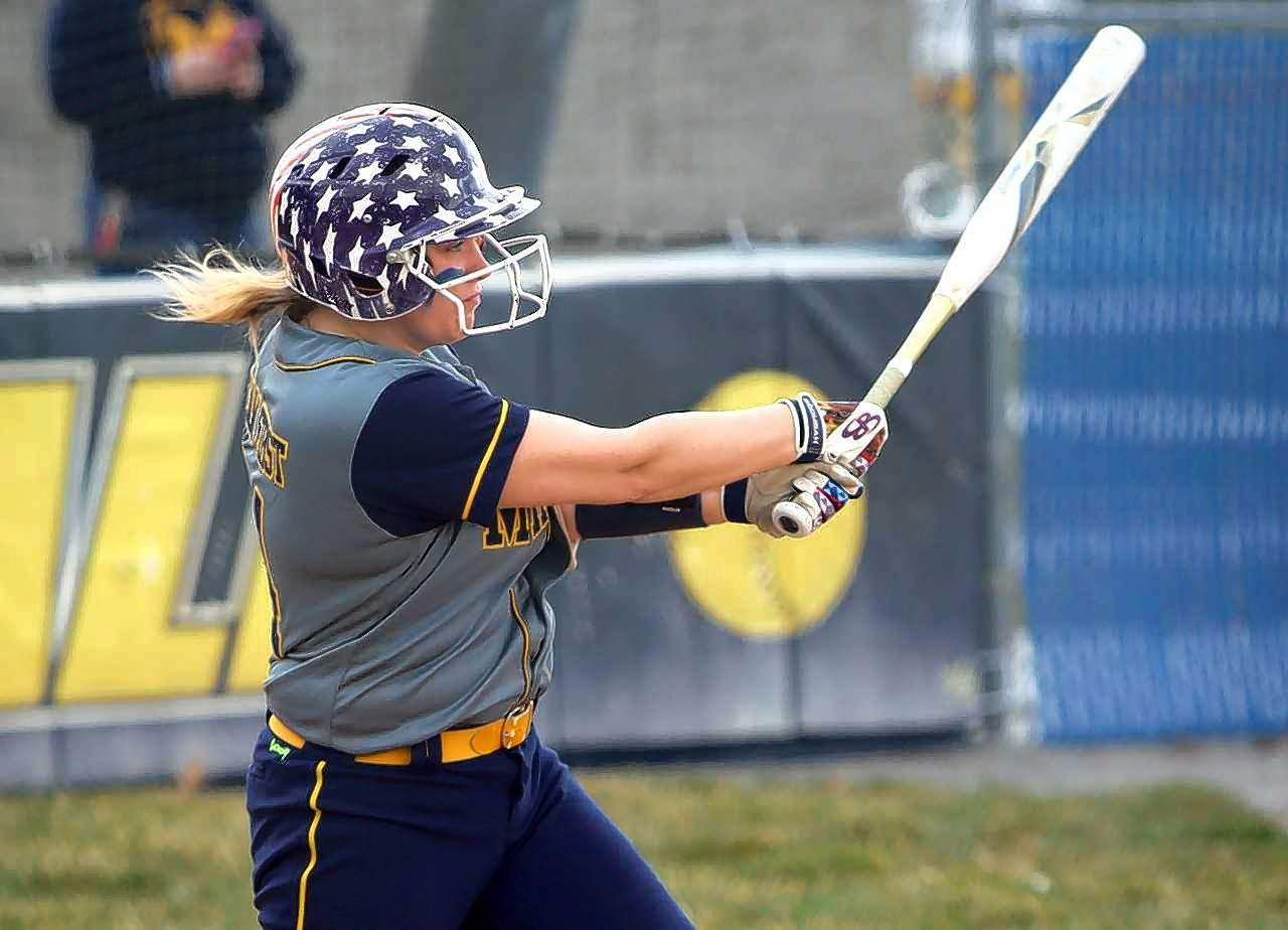 Andrea Roberts of the Wildcats drives in a run in the third inning.