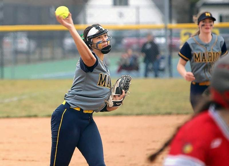 Marion pitcher Ivy Smart fields the ball and makes a putout at first. Smart struck out seven and earned the win in he season opener for the Wildcats.