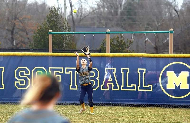 Morgan Andrews of the Wildcats catches a fly ball in center field.