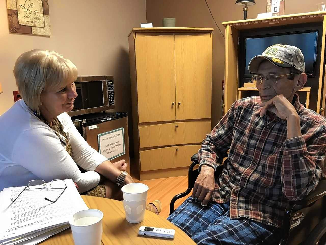 SusAnna Cook, Palliative Care Coordinator at the Marion VAMC, listens as Edwin Vega tells the story of his experiences with Charlie Company on a Vietnam hillside in 1969.