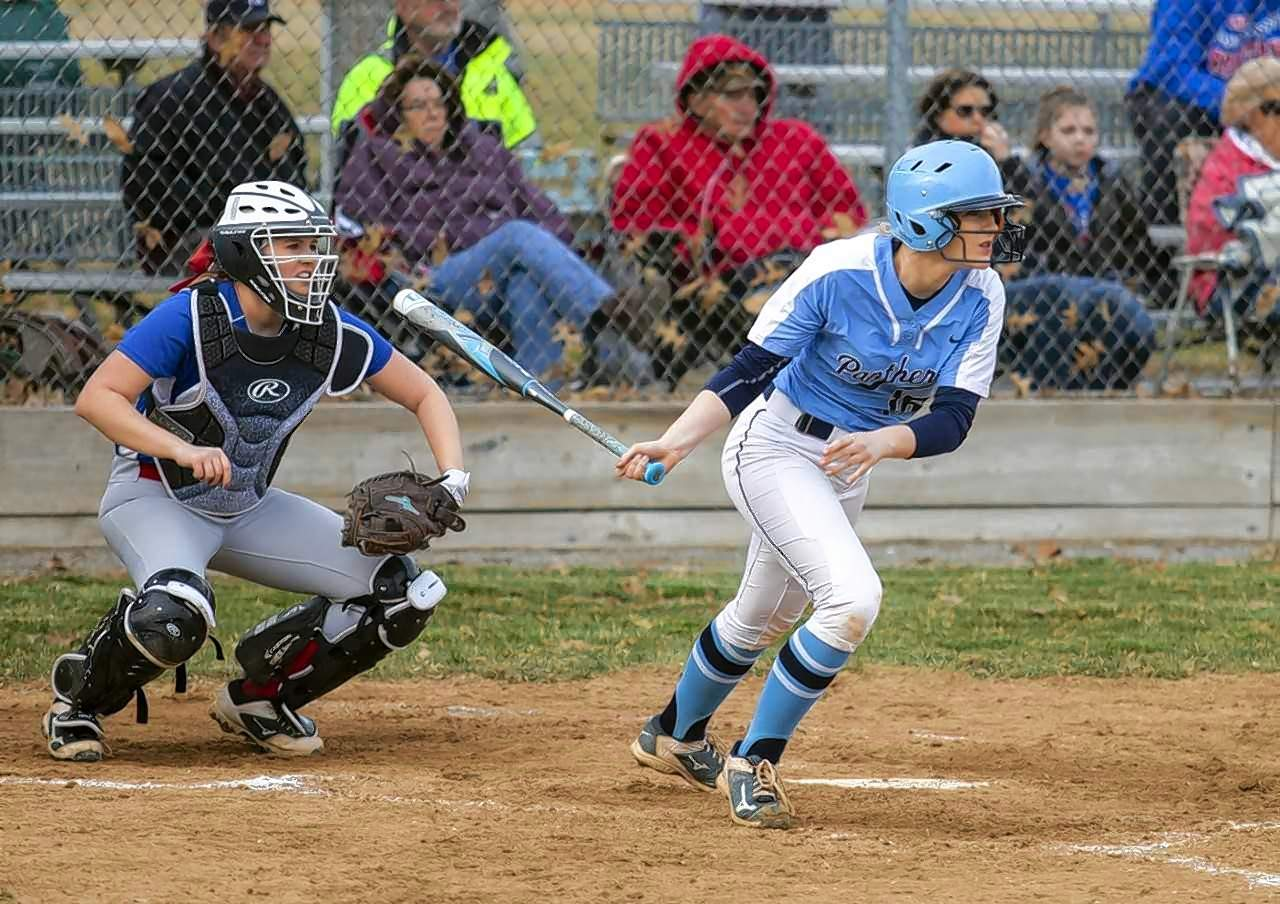 Pinckneyville's Taylor Witges delivers an RBI hit against Waltonville.