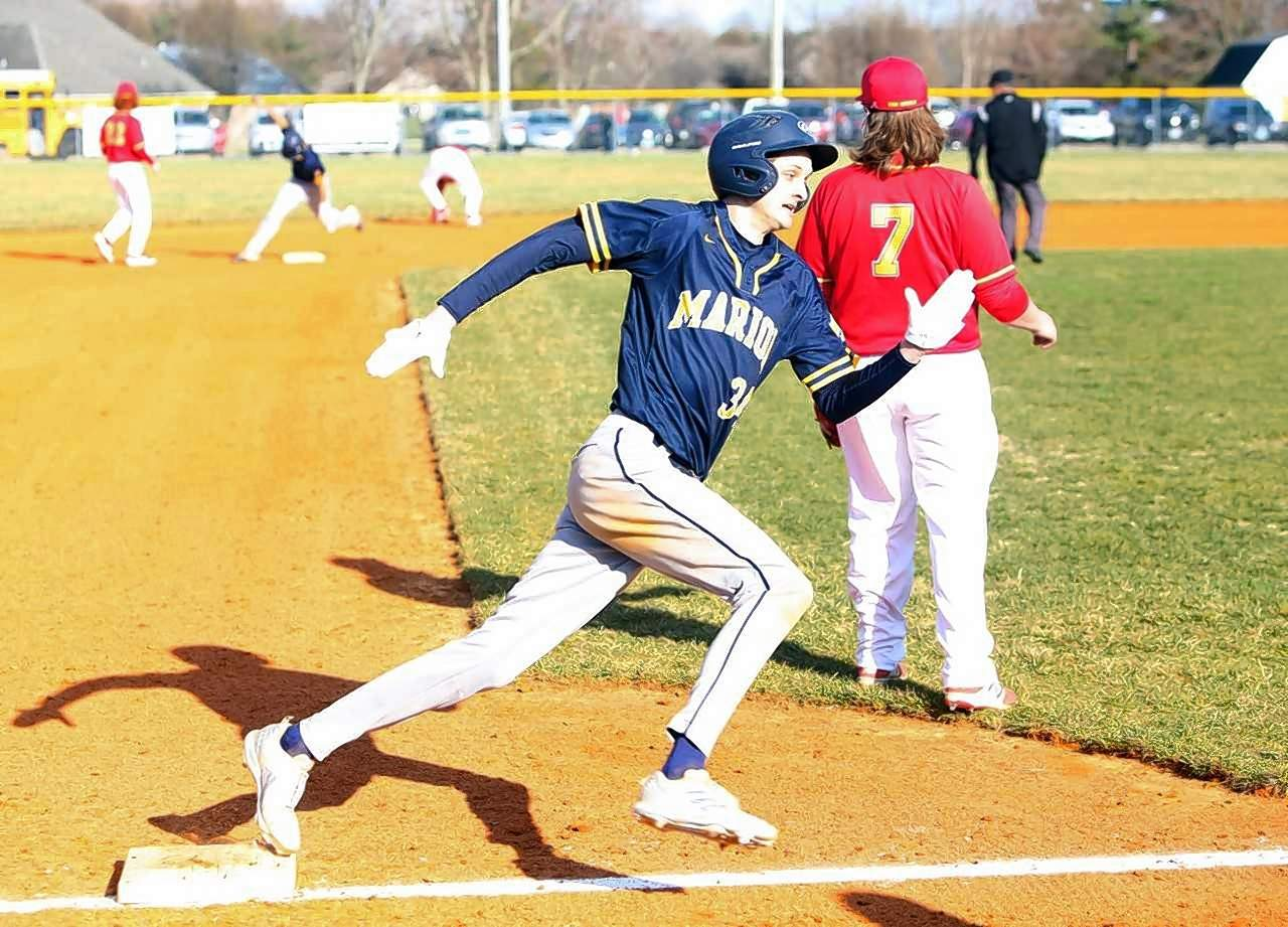 Marion's Mitchell Jackson rounds third base to score a run in the first inning.