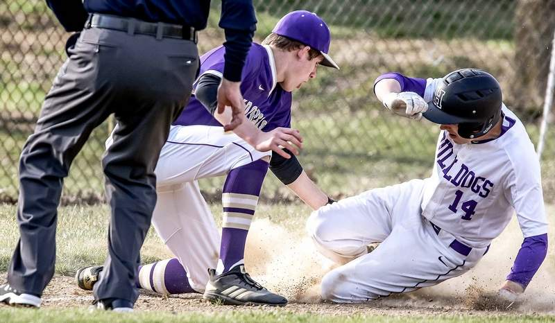 Eldorado's Nolan Milligan tags out Harrisburg's Javie Beal at third base Tuesday in the Eagles' ballgame against the Bulldogs at the EHS Sports Complex.