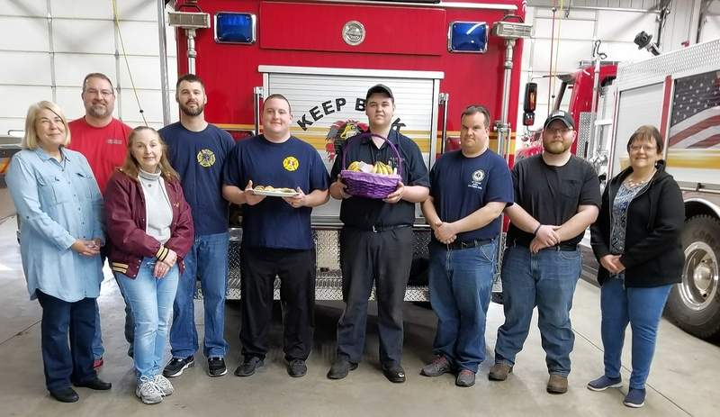 From left: Beta Nu members and firefighters are Jeanne Wagner, Mike Maciura, Kathy Belcher, Jeff Hammel, John Powell, Jared Meyer, Charlie Bargman II, Lake Fogerson and Joni Searles.