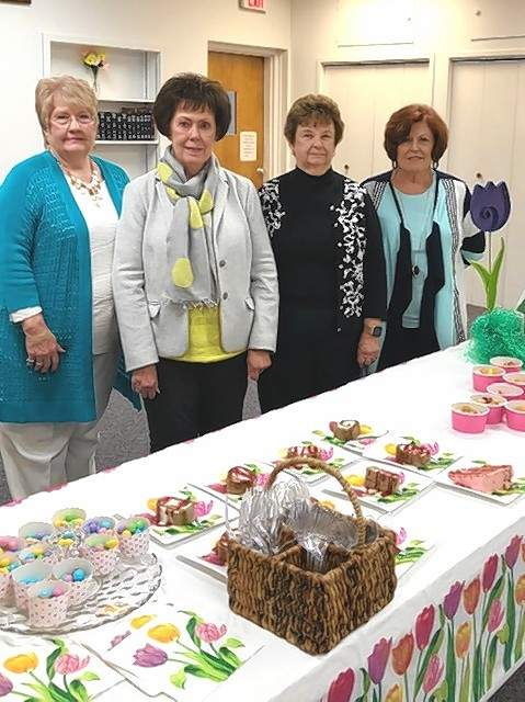 Hostesses included, from left, club members Ellen Butler, Cindy Drone, Wanda Brown and Donna Barton.